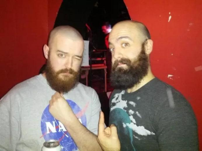 бритоголовые мужчины с бородой