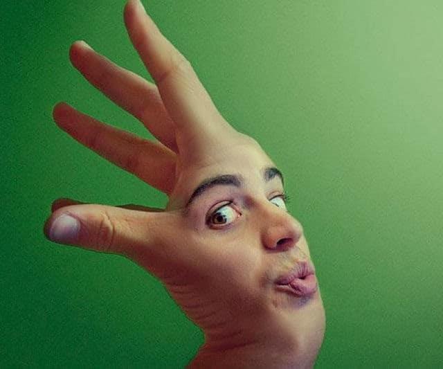 рука с человеческим лицом