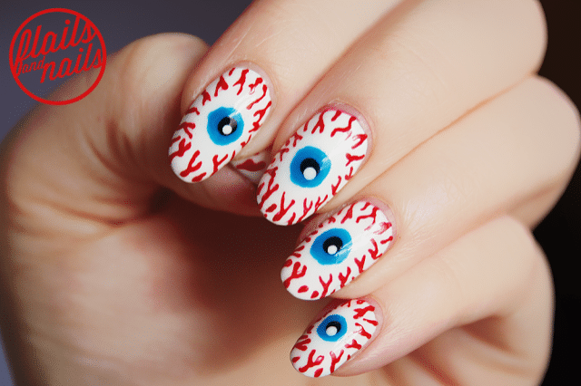 глаза нарисованные на ногтях