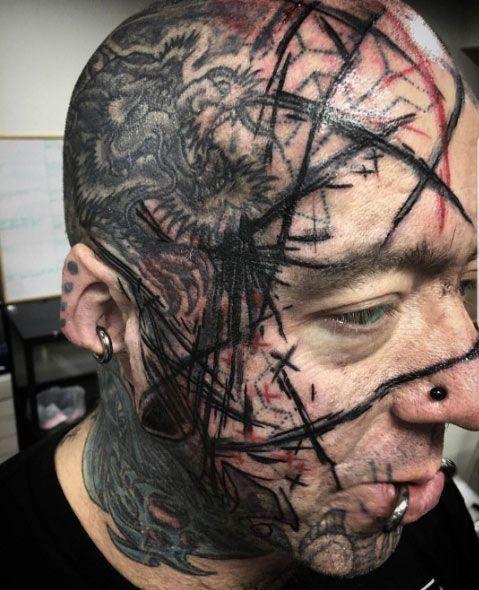 странные татуировки на лица