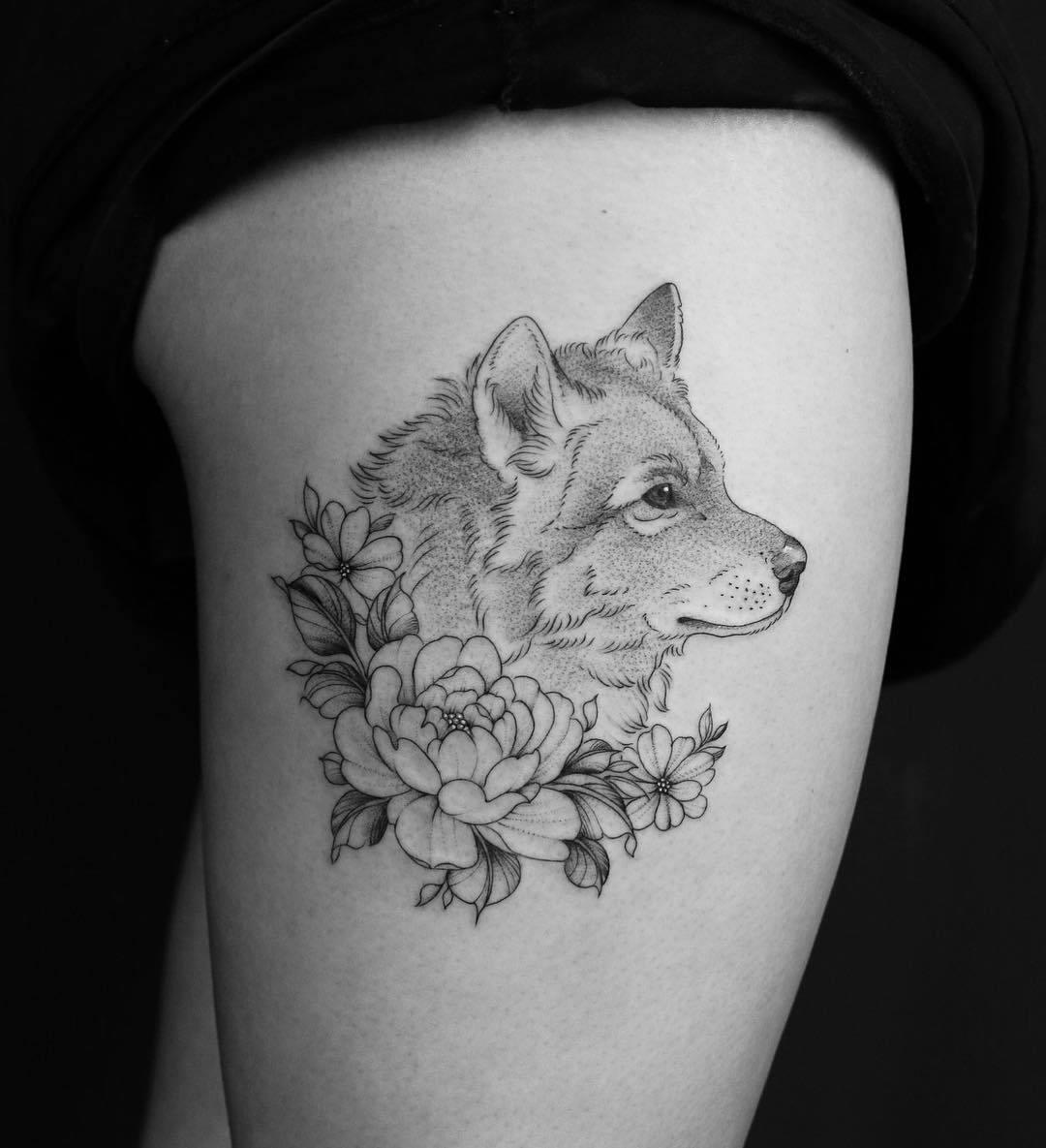 татуировка в виде волка