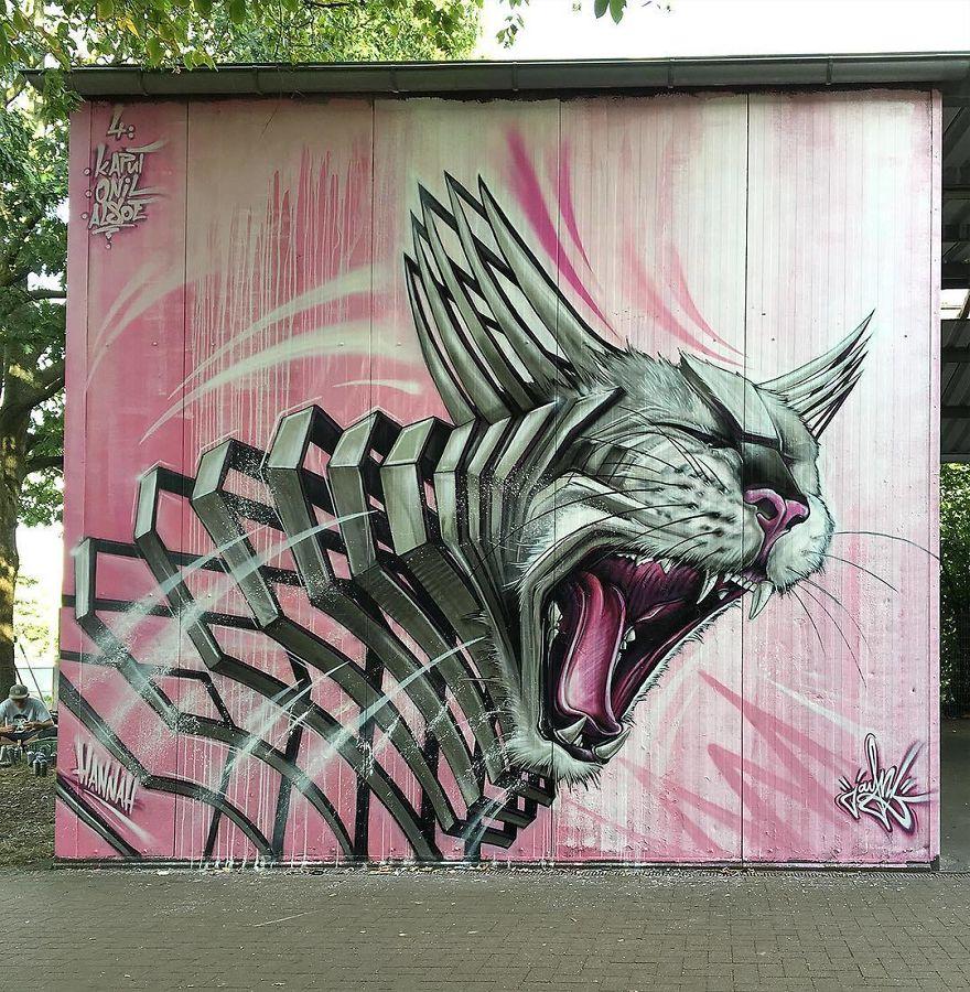 рисунок кота на стене