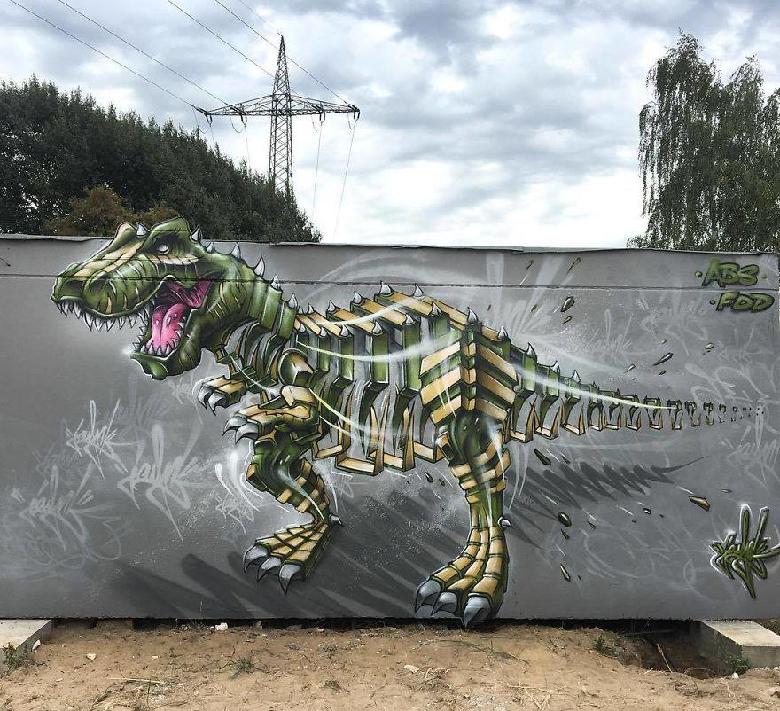 рисунок динозавра на заборе