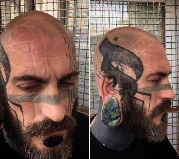 бородатый мужчина со шрамами на лице