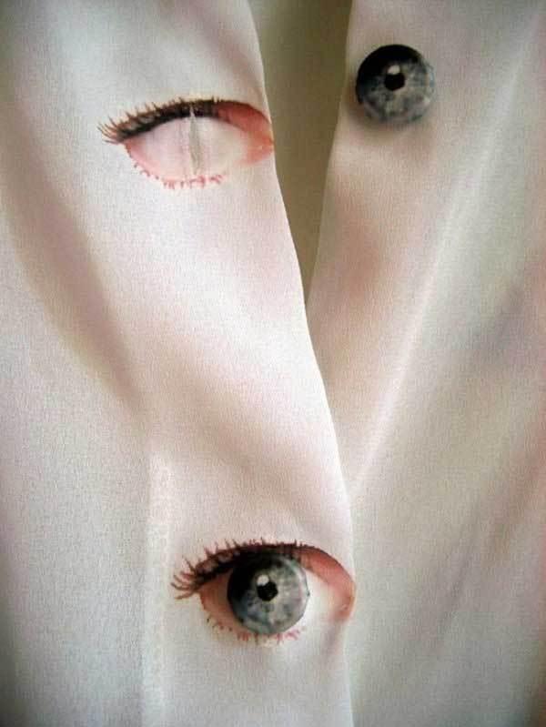 белая блузка с глазами
