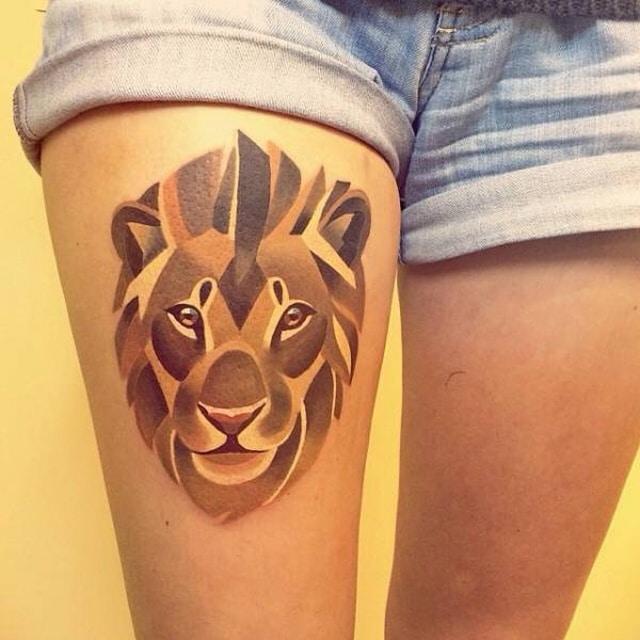 тату в виде льва
