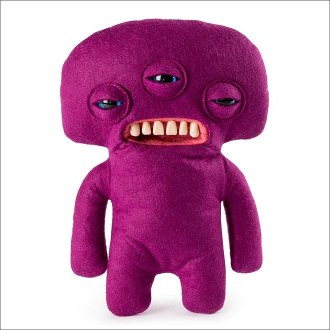 фиолетовая мягкая игрушка с тремя глазами