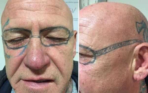 мужчина с татуировкой очков на лице